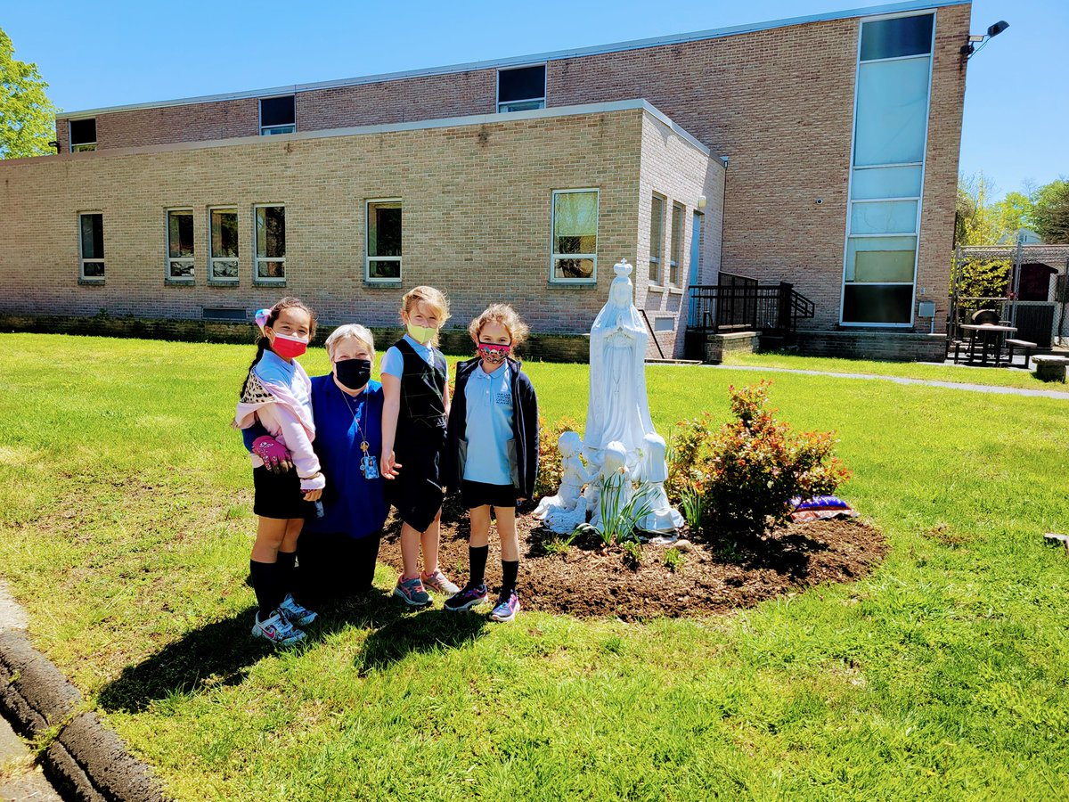 test Twitter Media - Mrs. O'Shea and students at @Ourladyoffatim8  freshening up the garden around our Blessed Mother Mary on a beautiful Spring afternoon. 💙 @Diobpt @BptSup https://t.co/qnd6Qou0da