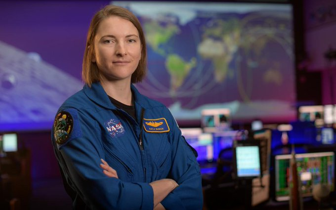 NASA astronaut Kayla Barron poses for a portrait, Wednesday, Sept. 16, 2020, in the Blue Flight Control Room at NASA's Johnson Space Center in Houston