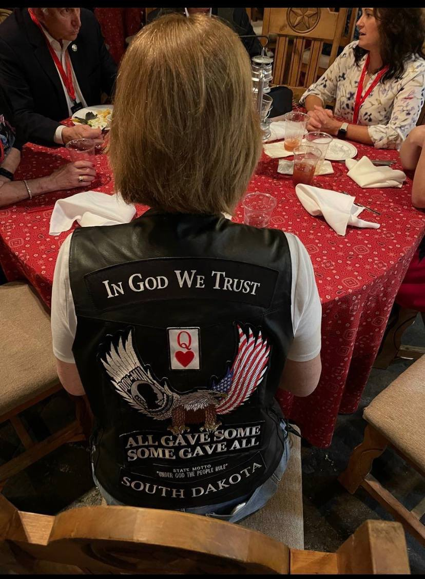 """Ron Filipkowski on Twitter: """"Back of Sidney Powell's biker vest at the  QAnon conference yesterday. Big red """"Q"""". Former attorney for the 45th  President of the United States. All the best people."""