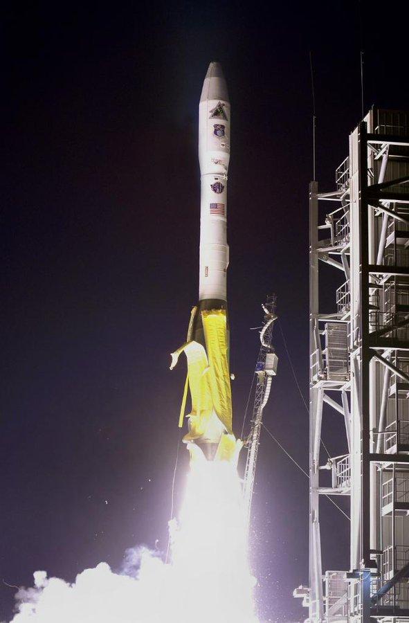 Minotaur I rocket launching at night.