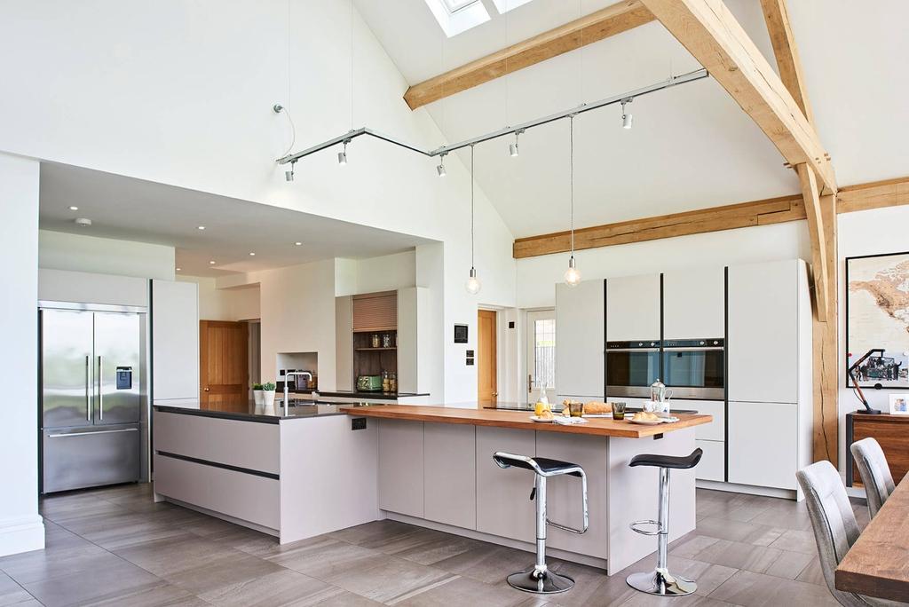 Expansive contemporary open plan kitchen in Hertfordshire.  #quartzworktops #porcelainflooring #greyfloors #interiordesign #design #kitchendesign #style #kitchendecor #kitchen #cabinets #cabinetdesign #kitchencupboards #kitchenorganization #kitchencabinets