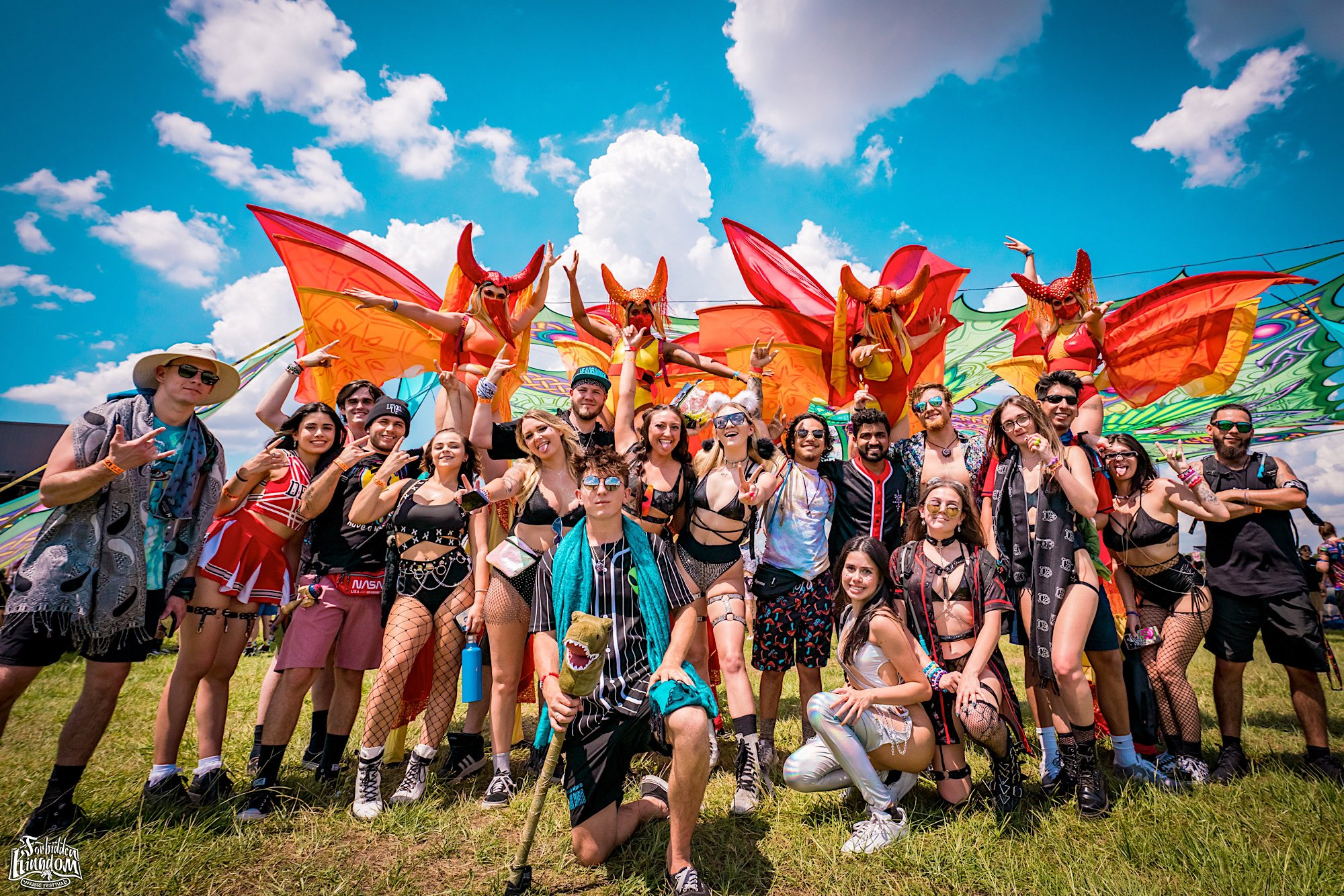 A group of festival-goers gather together to take a picture.