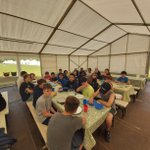 Year 8 relaxing in their private marquee after a busy morning  tomahawk throwing or climbing! Mr Close told his group that the lake was heated, so most were surprised when their raft building skills failed miserably!#copthorneprep #schooltrip