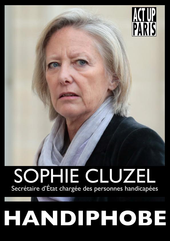 """Le mur des handiphobes de Act Up Paris. Une affiche noire avec une grande photo de Sophie Cluzel la Secrétaire d'Etat chargée des personnes handicapées avec le mot """"handiphobe"""" écrit en gros suite à son refus de déconjugaliser l'Allocation Adulte Handicapé."""