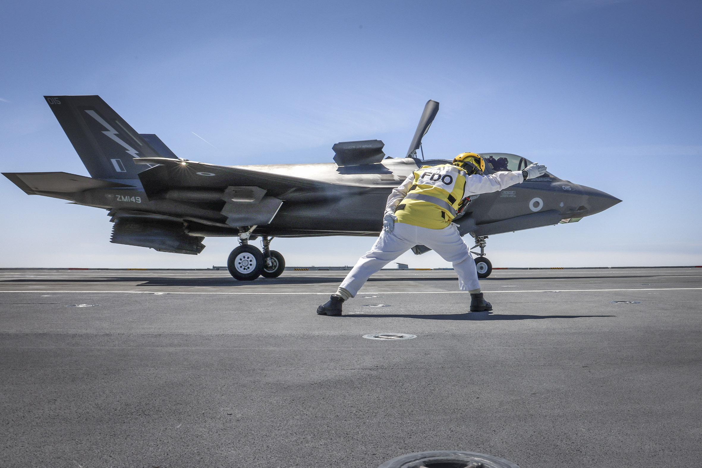 Go for launch - Flight Deck Officer Lieutenant Graham Blick gives the first launch of an F-35 the go-ahead