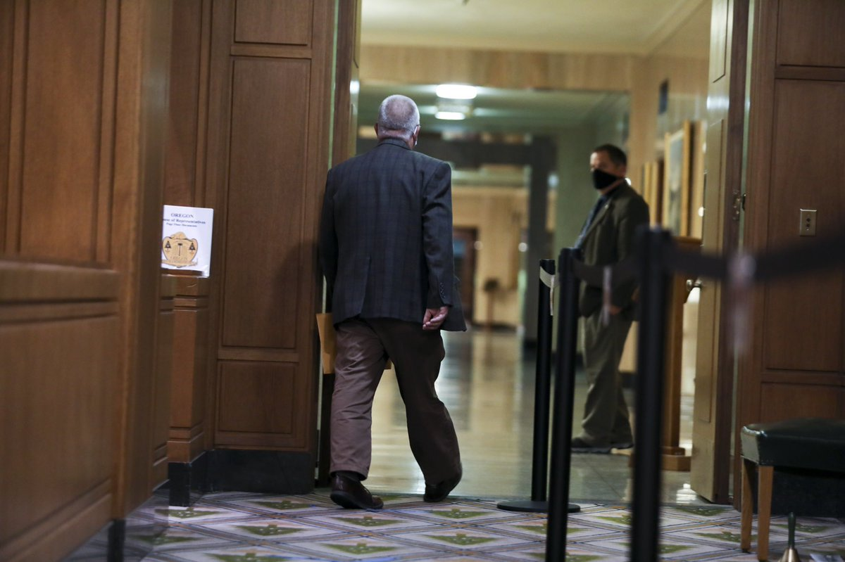 """Rep. Mike Nearman leaves the floor after the Oregon House of Representatives voted 59-1 to expel him for his actions on Dec. 12. Nearman let violent protesters into the Capitol, and later video showed him planning the action called """"Operation Hall Pass."""" https://t.co/wBn3ALCM1X"""