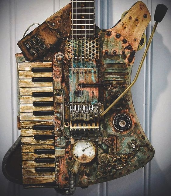 #Steampunk-ish ⚙️ Awesome of the Day ⭐ ➡️ Rusty #Vintage #Guitar 🎸 With Musical #Keyboard 🎹 via @CursedGuitars #SamaGuitars #SamaMusic 🎶 ➡️ View More #SamaCollection 👉 https://t.co/Kugls3IJqU