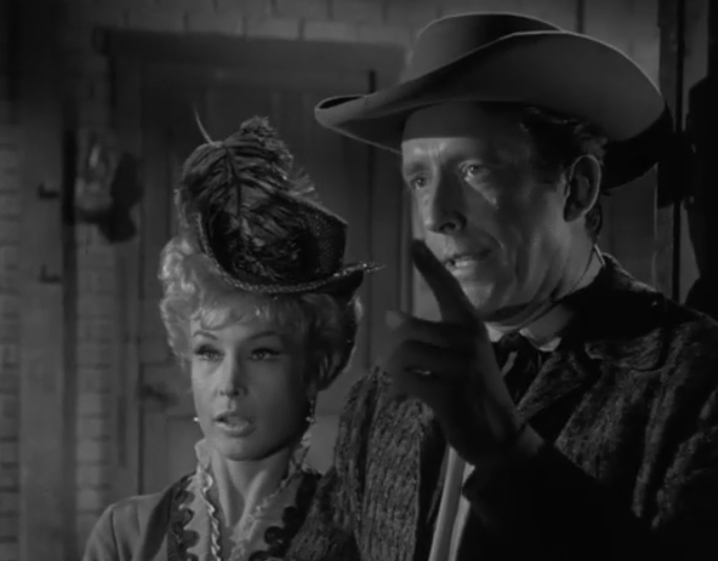Rawhide, Season 7, Episodes 7/8, Damon's Road. Usually Rowdy gets into a fight, here Gil Favor (Eric Fleming) has a drag-out fight with guest star Friz Weaver while Barbara Eden looks on. Who wins? At end of the episode, a battered Favor yells out,