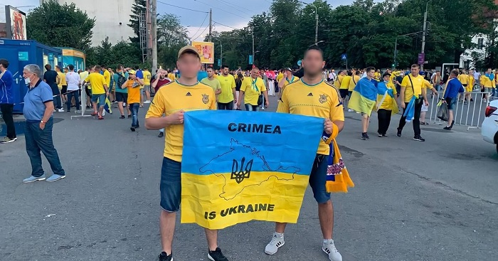 """Good job done by #police in #Romania #Bucharest during #EURO2020 . Police didn't allowed two #Ukrainian """"fans"""" to attend #Ukraine vs #Austria match due to political flag where it said #Crimea is Ukraine. As usual, Ukraine is blaming @EURO2020 #UEFA & #Gazprom for this """"incident"""" https://t.co/j2zheyYVb4"""
