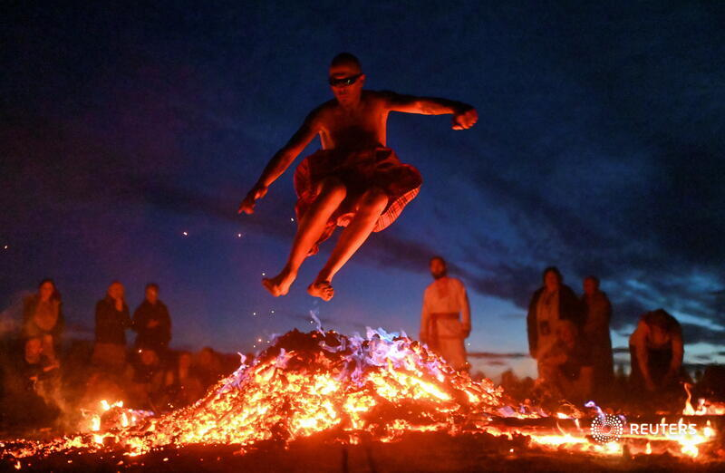 A man jumps over a bonfire during a celebration of the summer solstice at a festival in the village of Okunevo in Omsk region, Russia. More photos of the day: https://t.co/W1QGCjMKBj 📷 Alexey Malgavko https://t.co/o0pUDhFInR