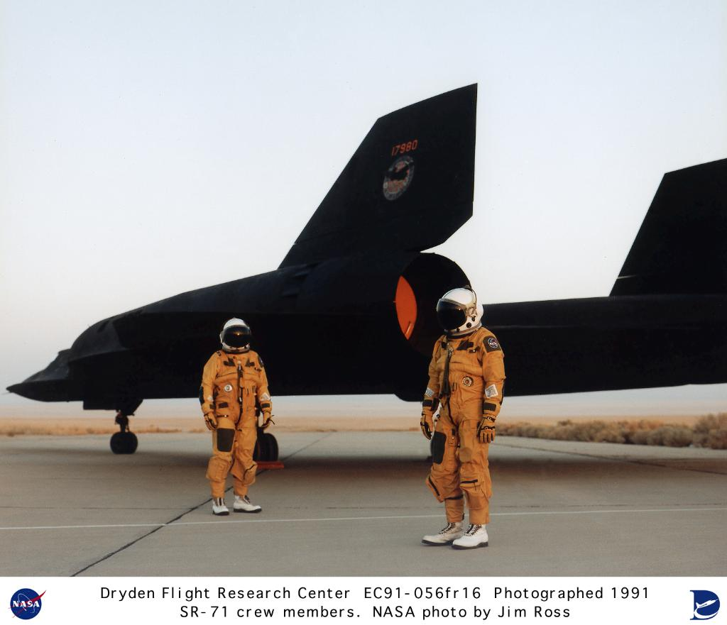 SR-71 Blackbird and flight crew on ramp.