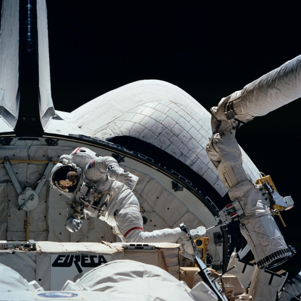 Astronaut on the outside of Space Shuttle Endeavour during a spacewalk.