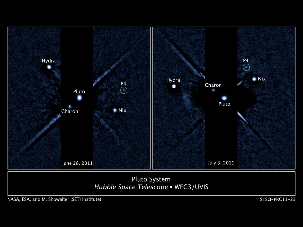 """Labeled image of Pluto and it's four moons. Kerberos is labelled as """"P4"""""""