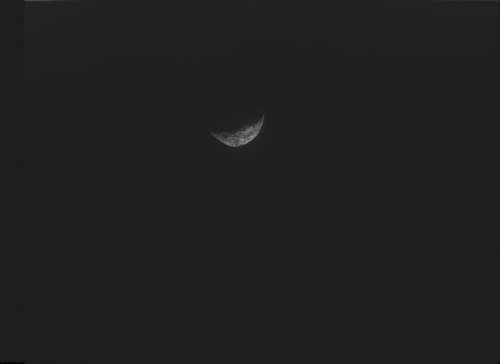 A photograph showing just the crescent of Bennu