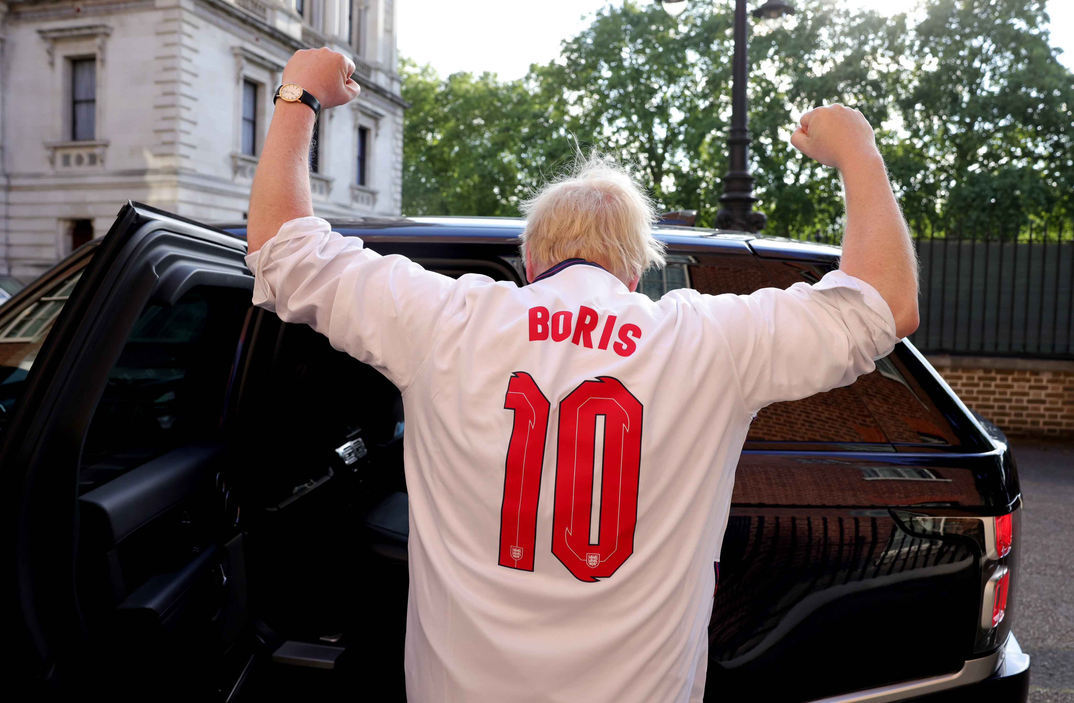 Prime Minister Boris Johnson leaves No10 Downing Street in his England shirt to watch England v Denmark in the semi-final of the Euro 2020 Championships.