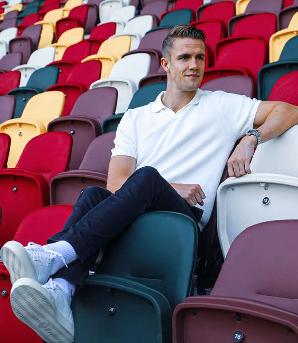 Kristoffer Ajer sits in the stands at the Brentford Community Stadium