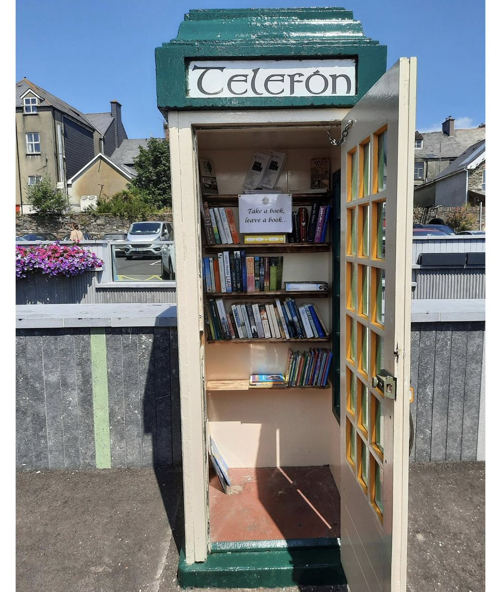 """Ya gotta love this. In Clonakilty they are using an old telephone box as a """"take a book leave a book"""" depot. https://t.co/fVp9VUOozP"""