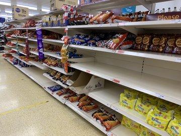 Panic Hits UK as Supermarket Shelves Go Bare E65k1B-X0AIg9n-?format=jpg&name=360x360