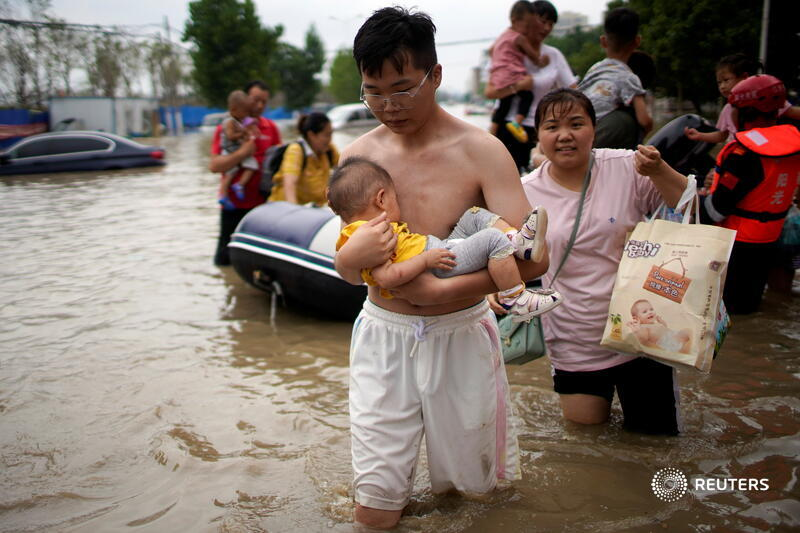 China evacuates tens of thousands as storm spreads north, death toll rises Photo