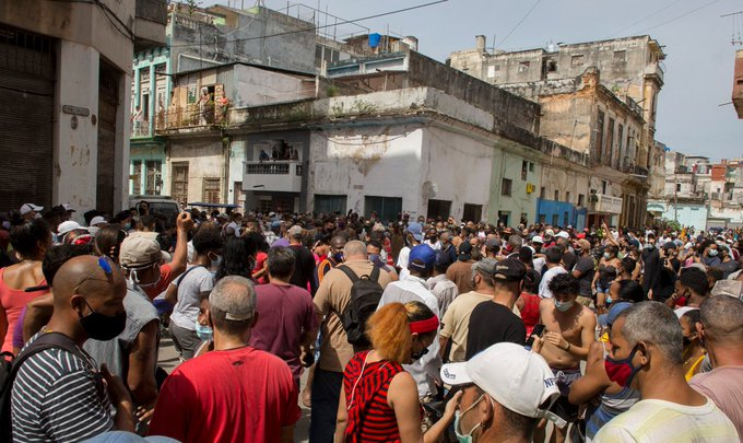 A anti-government protesters march in the streets in Havana, Cuba