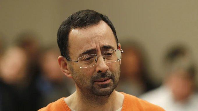 Larry Nassar, in court, looking down.