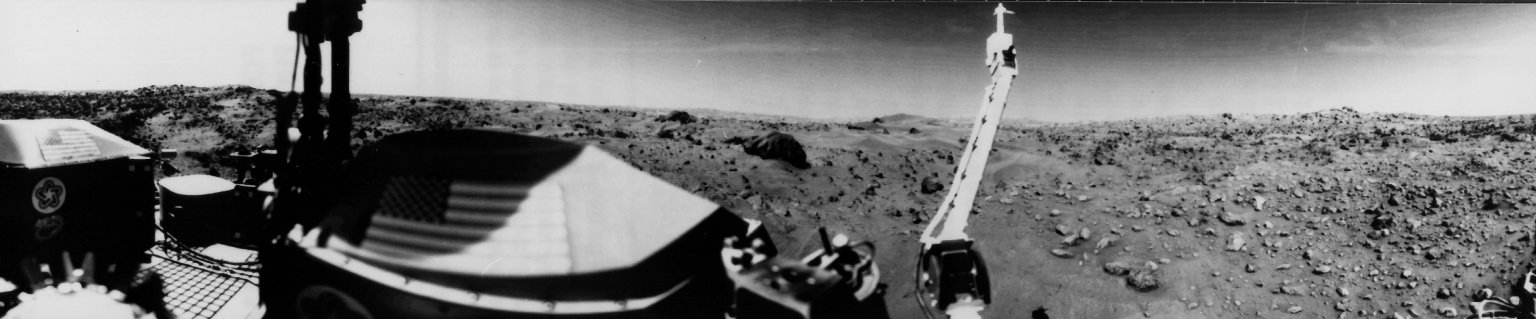 Sand dunes and large rocks are revealed in this panoramic image of Mars taken by Viking 1's Camera 1.