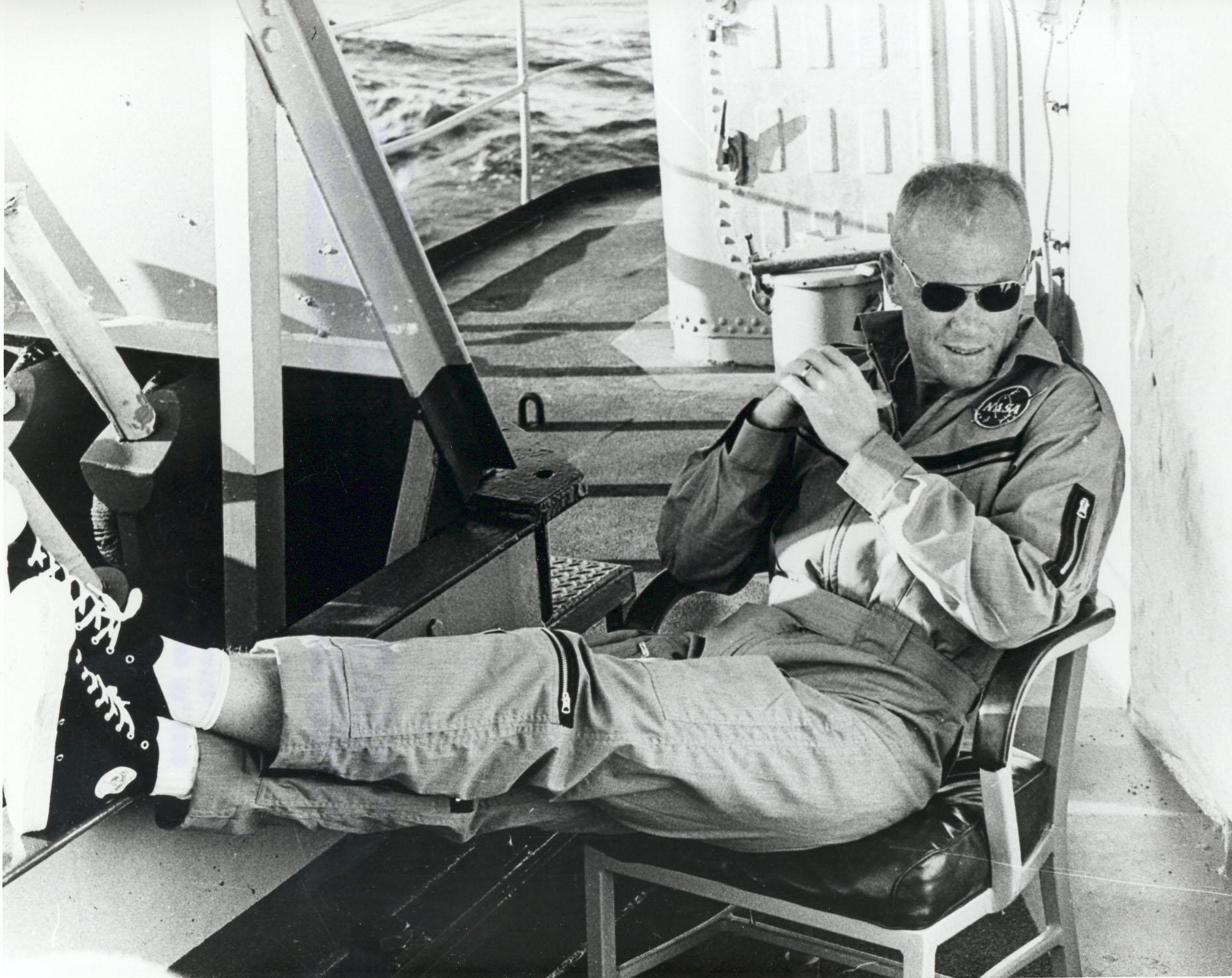 John Glenn wearing a flight suit and Converse