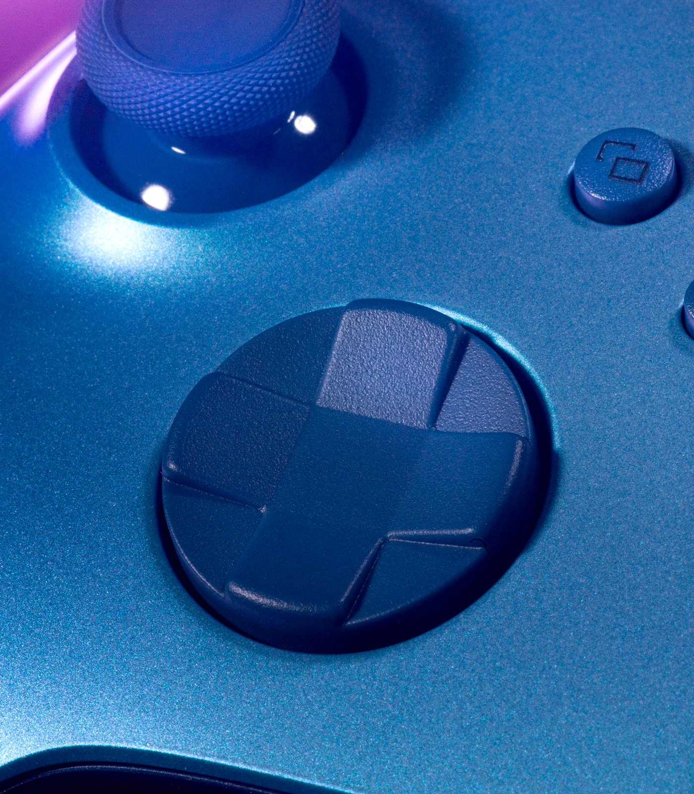 A close up of the blue Dpad of the Aqua Shift wireless controller.