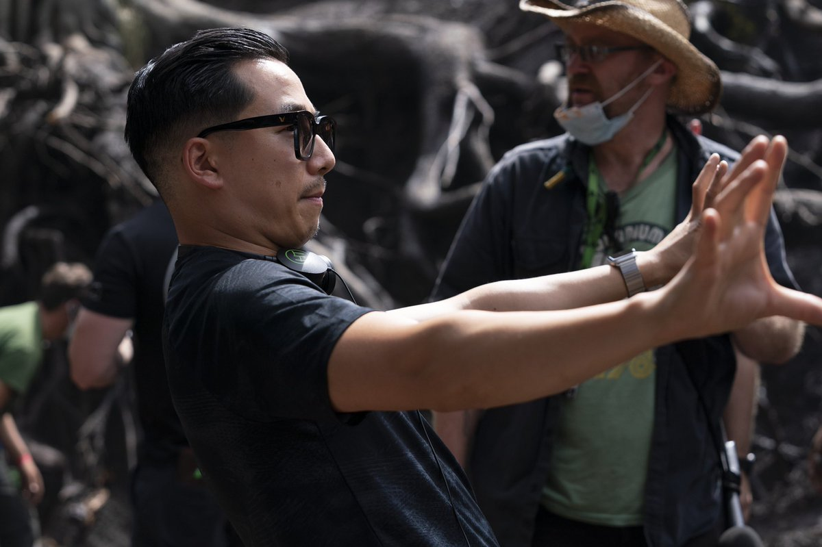 Director Wayne Che Yip lines up a shot on set using his hands as a framing device.