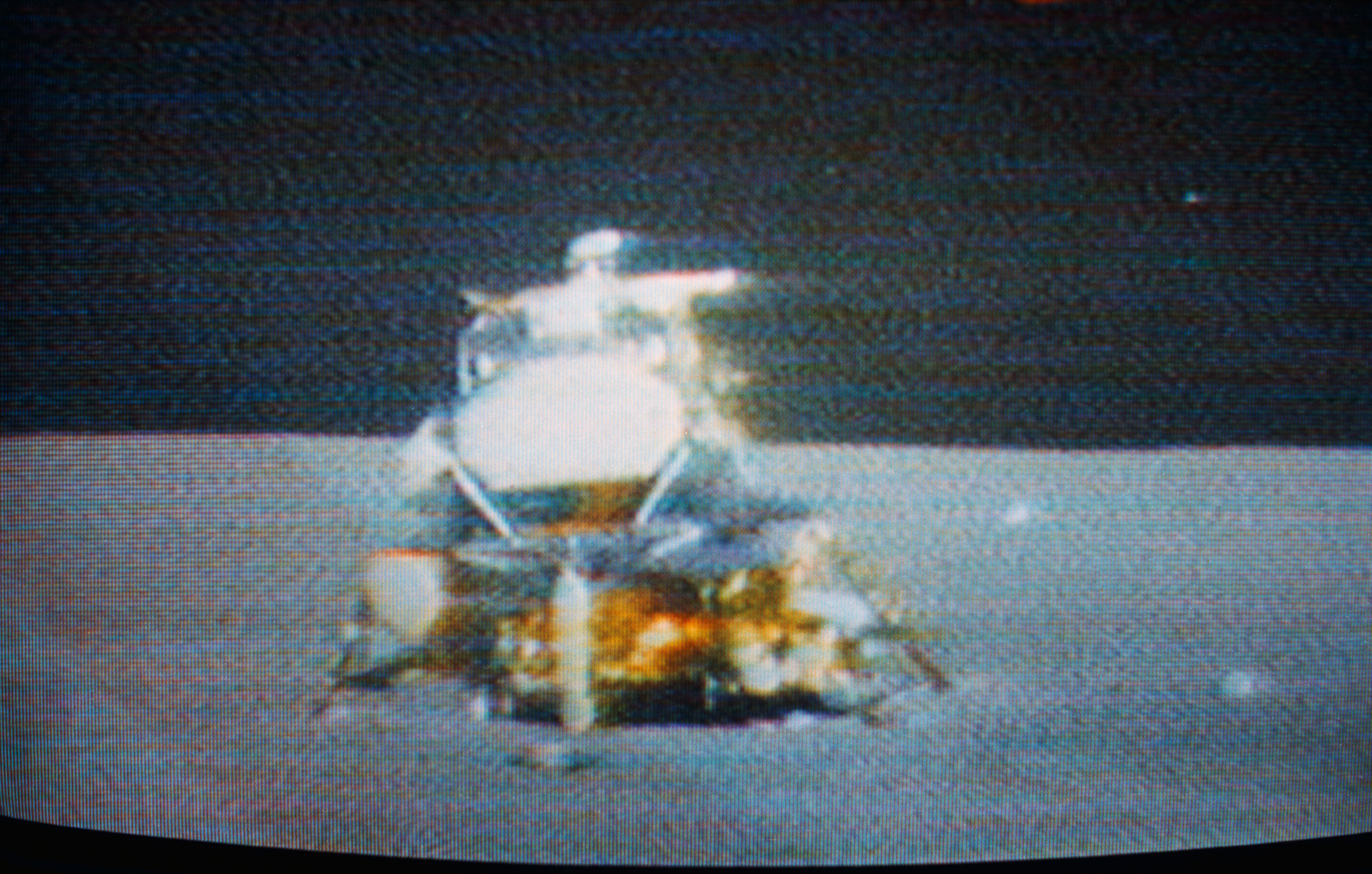 TV screen showing lunar module on the lunar surface just before liftoff to meet with the Command module.