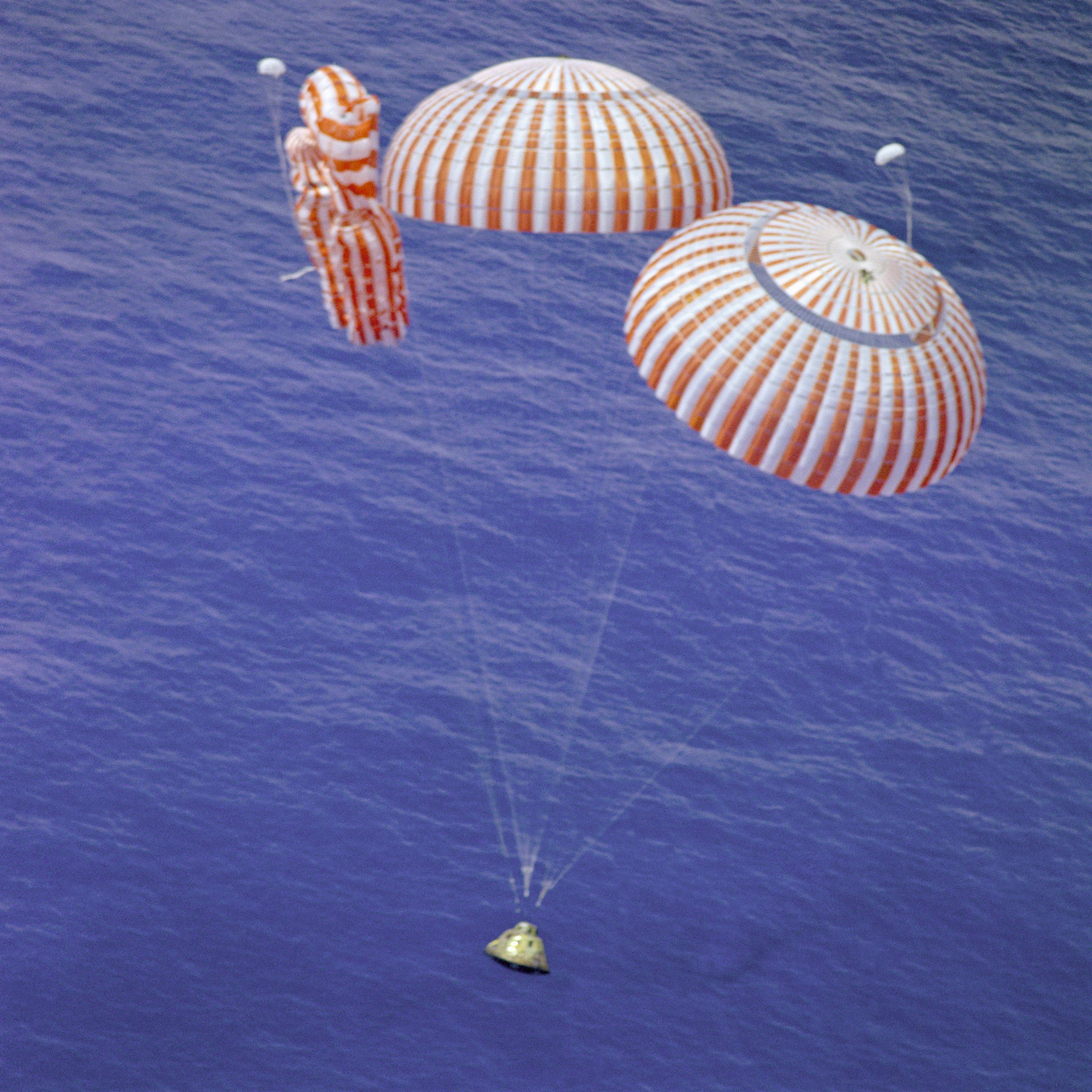 Photo of the Apollo 15 command module splashdown, two parachutes opened, and one did not.