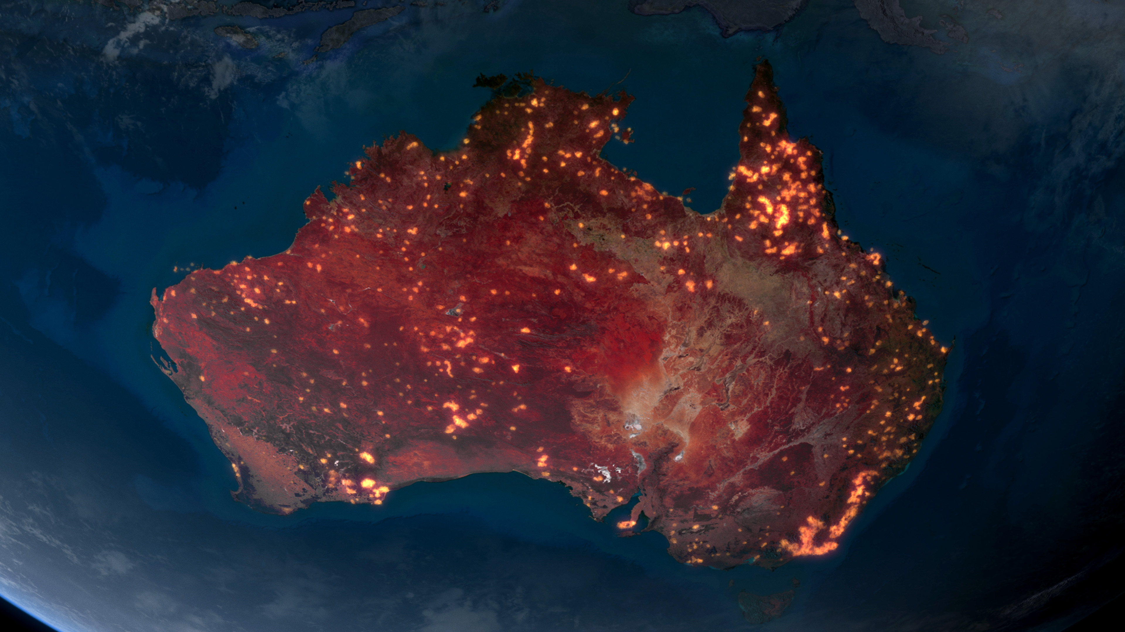 A shot of Australia from orbit in 2020, with massive wildfires dotting nearly every part of the continent.