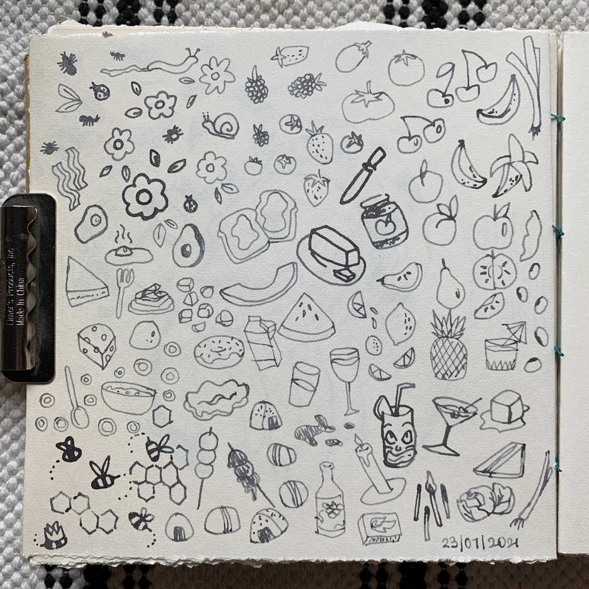 grey ink doodles of various objects from bugs to foods and drinks.
