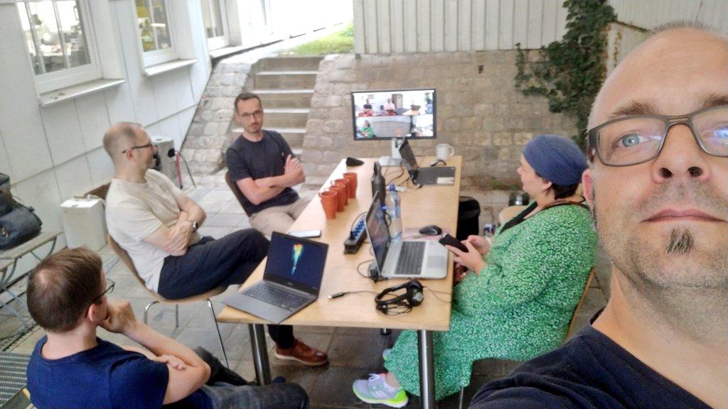 Björn, Frank, Tilman, Saskia and Joschi sitting in front of the tollwerk office (outdoor)
