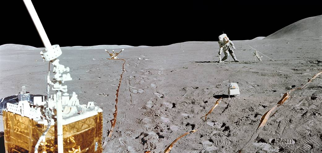 Mission commander David Scott is leaning to his right and is putting down the Apollo Lunar Surface drill used to take core samples and set up a heat flow experiment on the Moon's surface.