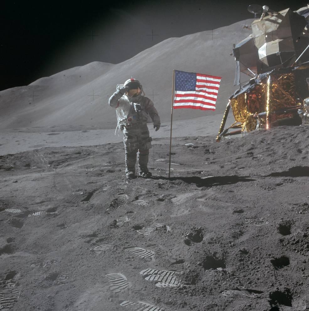 David Scott salutes the American flag, lunar lander in the background