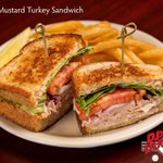 On a Summer day, our Honey Mustard Turkey Sandwich hits the spot! Layers of turkey breast, honey mustard, red onion, lettuce, and tomato on wheat berry bread. 😁 YUM!