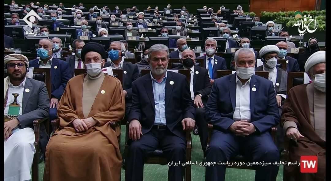 في احتفال تنصيب جلاد إيران إبراهيم رئيسي، تقدم الحضور اسماعيل هنية صديقه