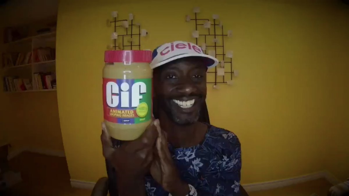 (Person holding a jar of peanut butter — w/ the letters GIF on it, in the same style as JIF brand)