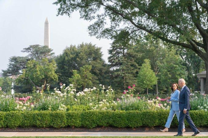 President Biden and Vice President Harris walk and talk along the White House Rose Garden.