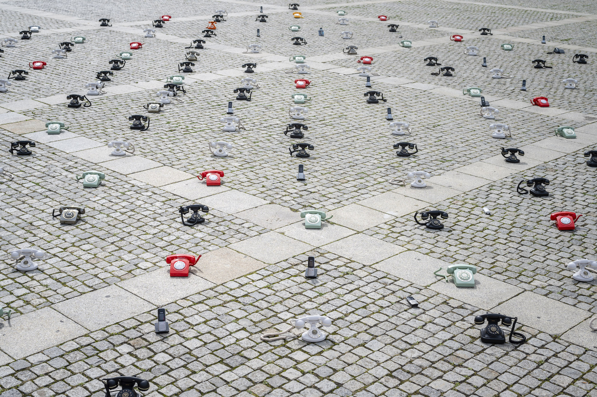 """The Syria Campaign on Twitter: """"Imagine waiting for years for a phone call.  Syrian families have placed hundreds of phones across Berlin's Bebelplatz  to demonstrate the scale of their suffering as they"""
