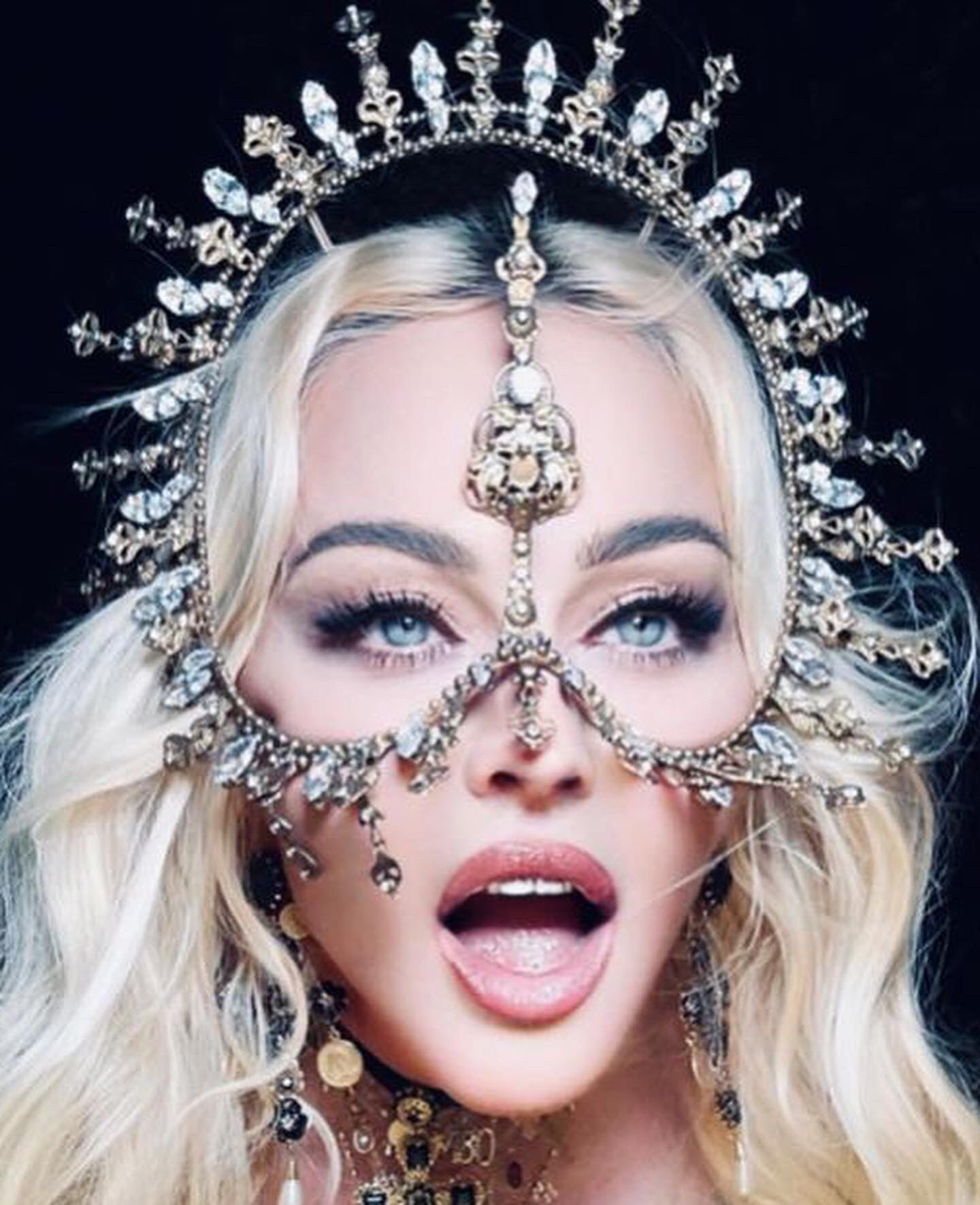 Happy 63rd Birthday to the iconic Celebrating in Italy with a custom headpiece.