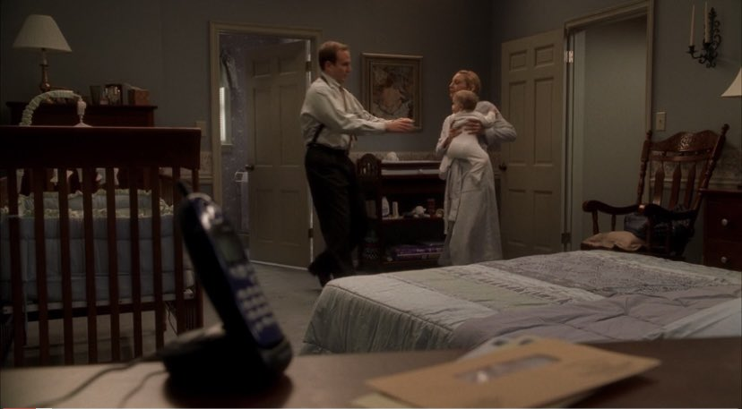 fbi agent deborah ciccerone gives her baby to her husband so she can get ready for work.