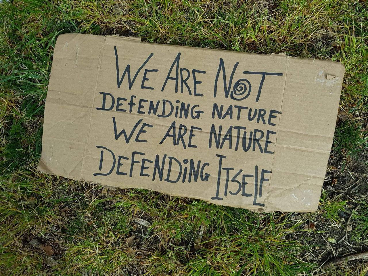 """Sign that says: """"we are not defending nature, we are nature defending itself"""""""