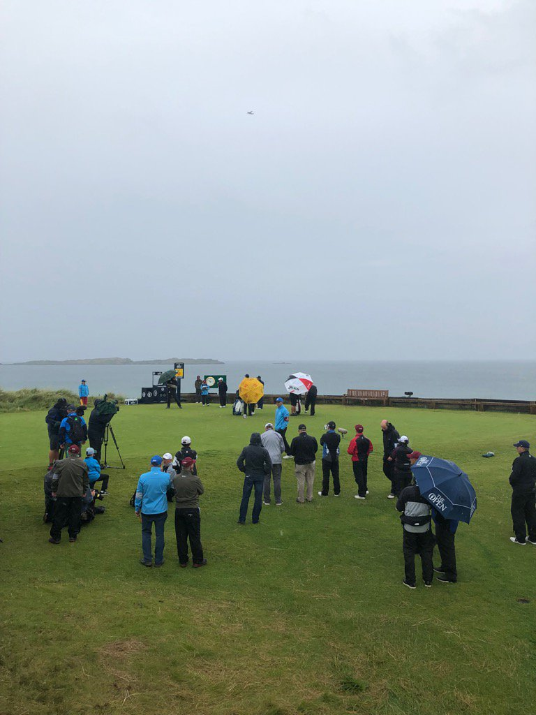Lowry's umbrella and Fleetwood's umbrella on 6th tee. Weather's coming in