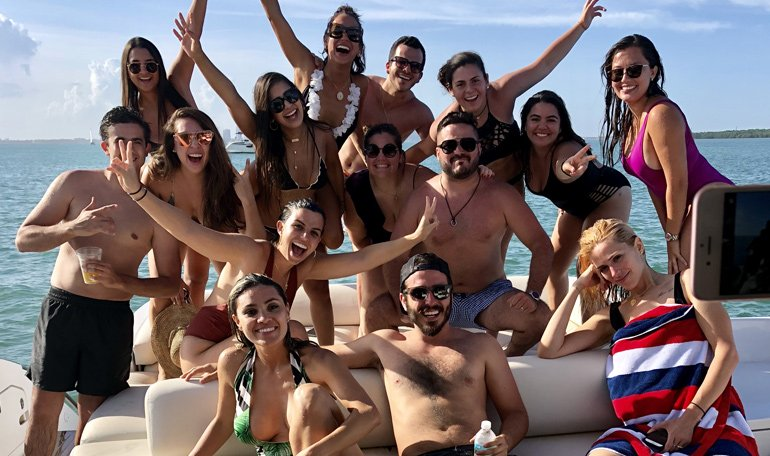 A group poses for a picture on the Black Ice yacht. #group #yachtcharter #blackiceyacht
