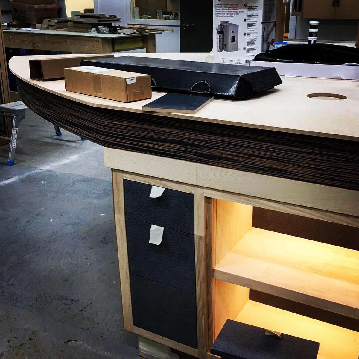 YDA team visit Innovate Furniture to see our concept come to life. A 'Riva' power boat inspired social island. Subliminal in shape, this functional island will create a balance between luxury and elegance. #workshop #kitchen #island #kitchenisland #workinprogress #concept #ideas