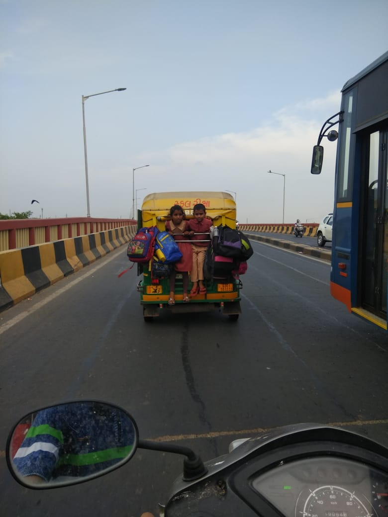 Really disappointed to see this in Ahmedabad... @AhmedabadPolice @ipsvipul_ Sir 🙏 Instead of punishment to Autowala,  I feel parents should be aware for risk of their children's life...  #children #RoadSafety PS: photo taken by my wife