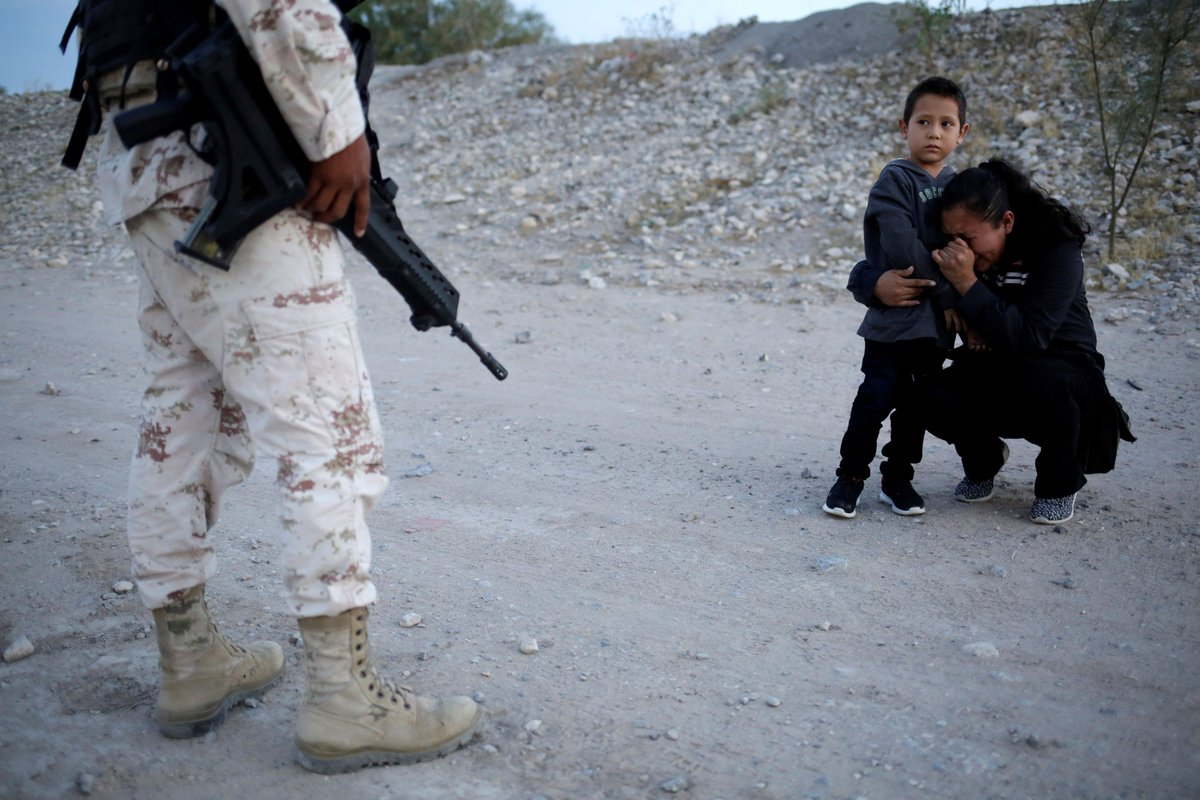 Photo Of Mother Pleading With Mexican Soldier Draws Attention To Migrant Patrol