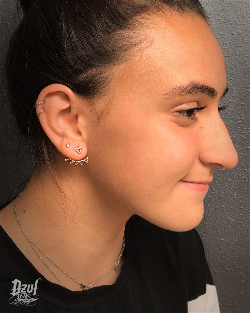 36d73fc91 Double helix piercing by Cata. Spice up your life with a couple of hoops in  your ears! #seattle #dzul #dzulinklounge #helix #helixpiercing  #seattlepiercing ...